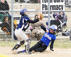 """<div class=""""source""""></div><div class=""""image-desc"""">Harley Marksbury attempts to tag out a Gallatin County player at the plate. The Lady Braves lost 7-0 to Gallatin County. </div><div class=""""buy-pic""""><a href=""""/photo_select/20240"""">Buy this photo</a></div>"""