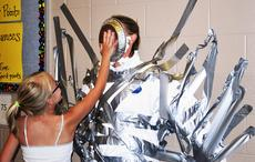 """<div class=""""source""""></div><div class=""""image-desc"""">SES gym teacher Jill Smith, get a pie in the face while being taped to the wall as part of a reward for the students. </div><div class=""""buy-pic""""><a href=""""/photo_select/21068"""">Buy this photo</a></div>"""