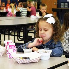 "<div class=""source""></div><div class=""image-desc"">MCE student Riley DeMatteo makes a sour face as she eats her breakfast. </div><div class=""buy-pic""><a href=""http://web2.lcni5.com/cgi-bin/c2newbuyphoto.cgi?pub=195&orig=pic_3_61.jpg"" target=""_new"">Buy this photo</a></div>"