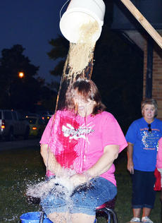 """<div class=""""source""""></div><div class=""""image-desc"""">Linda Breeden, food service manager at Dry Ridge Elementary was a good sport when it came time to be in the 'hillbilly dunking' booth during the school's Fall Fest on Sept. 27.</div><div class=""""buy-pic""""><a href=""""/photo_select/19013"""">Buy this photo</a></div>"""