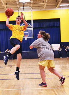 """<div class=""""source""""></div><div class=""""image-desc"""">Austin Green shoots the ball as Elizabeth Dalzell, guidance counselor, comes in to defend. </div><div class=""""buy-pic""""><a href=""""/photo_select/20750"""">Buy this photo</a></div>"""