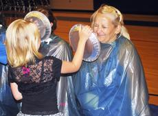 """<div class=""""source""""></div><div class=""""image-desc"""">SES student Shyanne Schwartz puts a pie in the face of Tonya Deitz as part of a reward for a fundraiser. Photos by Camille McClanahan</div><div class=""""buy-pic""""><a href=""""/photo_select/21069"""">Buy this photo</a></div>"""