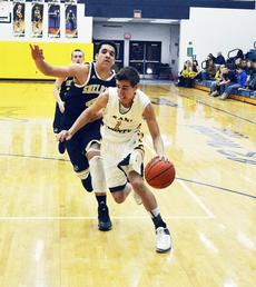 """<div class=""""source""""></div><div class=""""image-desc""""> Bo Hammons attempts to go through the baseline for a basket against Shelby County High School. Hammons was injured and taken to the hospital after the game where he was treated and released. </div><div class=""""buy-pic""""><a href=""""http://web2.lcni5.com/cgi-bin/c2newbuyphoto.cgi?pub=195&orig=pic_4_7.jpg"""" target=""""_new"""">Buy this photo</a></div>"""