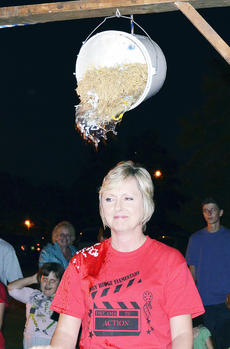 """<div class=""""source""""></div><div class=""""image-desc""""> Bobbie Jo Pelfrey, principal, was a good sport when it came time to be in the 'hillbilly dunking' booth during the school's Fall Fest on Sept. 27.</div><div class=""""buy-pic""""><a href=""""/photo_select/19015"""">Buy this photo</a></div>"""