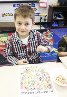 "<div class=""source""></div><div class=""image-desc"">MCE student Kinmon Chandler celebrated  the 100th day of school in Jackie Crupper's kindergarten class by making a necklace with 100 pieces of cereal. Photo submitted</div><div class=""buy-pic""><a href=""/photo_select/20012"">Buy this photo</a></div>"