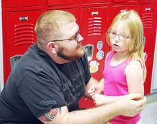 "<div class=""source""></div><div class=""image-desc"">DRE kindergartner Melina Blackmore hugs her dad, James Blackmore goodbye on the first day of school.  </div><div class=""buy-pic""><a href=""http://web2.lcni5.com/cgi-bin/c2newbuyphoto.cgi?pub=195&orig=pic_5_43.jpg"" target=""_new"">Buy this photo</a></div>"