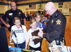"<div class=""source""></div><div class=""image-desc"">Deputy Lee Jacobs demostrates how a fingerprinting kit works to Abigail Hopkins and Kendall Mullins.</div><div class=""buy-pic""><a href=""/photo_select/19332"">Buy this photo</a></div>"