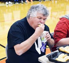 """<div class=""""source""""></div><div class=""""image-desc"""">T.J. West chows down at the hotdog eating contest. Photos by Jerry Morris</div><div class=""""buy-pic""""><a href=""""/photo_select/19361"""">Buy this photo</a></div>"""