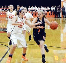 """<div class=""""source""""></div><div class=""""image-desc"""">WHS girls basketball player Katie Cheek drives the lane against Sammie Souder.</div><div class=""""buy-pic""""><a href=""""/photo_select/19363"""">Buy this photo</a></div>"""