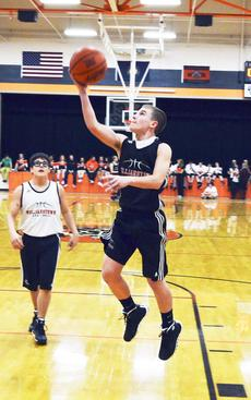 """<div class=""""source""""></div><div class=""""image-desc"""">Brennan Stanley lays the ball in the basket while Walker Angel watches.</div><div class=""""buy-pic""""><a href=""""/photo_select/19362"""">Buy this photo</a></div>"""