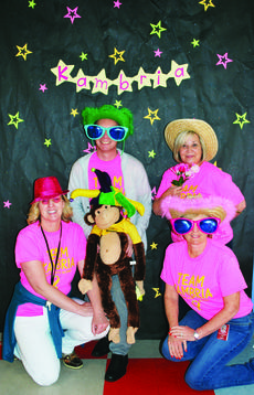 """<div class=""""source""""></div><div class=""""image-desc"""">Mike DiMera, SES guidance counselor,  Susan Marksberry, SES bookkeeper, Shannon Brickler, SES curriculum specialist and Lynn Nantz, SES attendance clerk have fun with the photo props. Photos by Camille McClanahan</div><div class=""""buy-pic""""><a href=""""/photo_select/26314"""">Buy this photo</a></div>"""