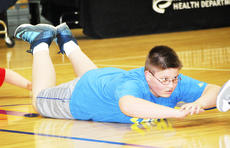 """<div class=""""source""""></div><div class=""""image-desc"""">Tanner Isaacs focuses on a grueling exercise. </div><div class=""""buy-pic""""><a href=""""/photo_select/20498"""">Buy this photo</a></div>"""