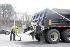 "<div class=""source"">Bryan Marshall</div><div class=""image-desc"">Kentucky Transportation Cabinet workers fill potholes on Interstate 75 in Crittenden as temperatures warm up</div><div class=""buy-pic""><a href=""/photo_select/9256"">Buy this photo</a></div>"