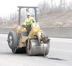 "<div class=""source"">Bryan Marshall</div><div class=""image-desc"">Workers smooth over the new asphalt to cover up the potholes on Interstate 75 near Crittenden.</div><div class=""buy-pic""><a href=""/photo_select/9259"">Buy this photo</a></div>"