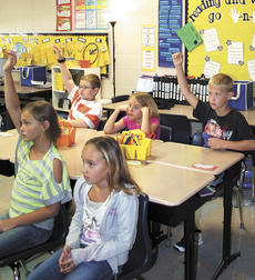"""<div class=""""source"""">Jamie Baker-Nantz </div><div class=""""image-desc"""">Leigh Anne of Florence, owner of Woody, answers a question about one of her books she wrote and the many adventures they contain at Sherman Elementary School. </div><div class=""""buy-pic""""><a href=""""/photo_select/15963"""">Buy this photo</a></div>"""