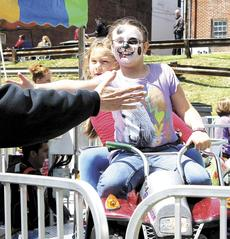 "<div class=""source""></div><div class=""image-desc"">Destiny Sewell and Kirsten Barker enjoyed giving high five's from the rides. </div><div class=""buy-pic""><a href=""/photo_select/20597"">Buy this photo</a></div>"