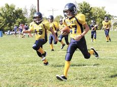 """<div class=""""source""""></div><div class=""""image-desc"""">Jacob Vickers, who has battled cancer since he was 6 years old, was given the honor of running in his team's first touchdown.</div><div class=""""buy-pic""""><a href=""""/photo_select/15530"""">Buy this photo</a></div>"""
