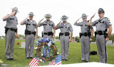 """<div class=""""source"""">Bryan Marshall, staff writer</div><div class=""""image-desc"""">Trooper Mark Grisik, Trooper Doug Carter, Sgt. Stacey May, Trooper Rick St. Blanchard, Trooper Jeremy Moore and Sgt. Aaron Beighle placed a wreath at the grave of Joe Ward Jr. in memory of National Police Memorial Week.</div><div class=""""buy-pic""""><a href=""""/photo_select/2998"""">Buy this photo</a></div>"""