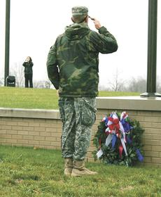 """<div class=""""source""""></div><div class=""""image-desc""""> Devin Cummins, a member of the Grant County High School JROTC, salutes a wreath placed at the Kentucky Veterans Cemetery North on Nov. 12. Photo by Jamie Baker-Nantz</div><div class=""""buy-pic""""><a href=""""/photo_select/16202"""">Buy this photo</a></div>"""