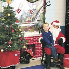 """<div class=""""source""""></div><div class=""""image-desc"""">Dry Ridge Elementary preschooler Wyatt Brown takes time to tell Santa if he has been naughty or nice before telling him what he would like for Christmas.</div><div class=""""buy-pic""""><a href=""""/photo_select/16576"""">Buy this photo</a></div>"""