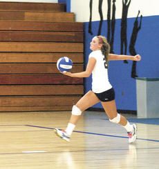 """<div class=""""source""""></div><div class=""""image-desc"""">Raven Wilson serves against Walton-Verona on Aug. 23. The Lady Braves have started their season with three wins and are now ranked as one of the top five teams in the 8th region. Photo by Haleigh Jacobs</div><div class=""""buy-pic""""><a href=""""http://web2.lcni5.com/cgi-bin/c2newbuyphoto.cgi?pub=195&orig=serving_0.jpg"""" target=""""_new"""">Buy this photo</a></div>"""