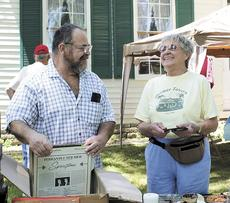 "<div class=""source""></div><div class=""image-desc"">Barbara Brown, a member of Friends of Sherman Tavern, converses with Larry Pier of Corinth during the U.S. 25 yard sale last week. Photo by Jamie Baker-Nantz</div><div class=""buy-pic""><a href=""http://web2.lcni5.com/cgi-bin/c2newbuyphoto.cgi?pub=195&orig=shopping_0.jpg"" target=""_new"">Buy this photo</a></div>"
