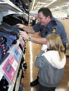 "<div class=""source"">unknown</div><div class=""image-desc"">Capt. Steven Skinner of the Grant County Detention Center helps a child shop at the Shop With A Cop program on Dec. 7. Photos by Jamie Baker-Nantz</div><div class=""buy-pic""><a href=""/photo_select/19518"">Buy this photo</a></div>"