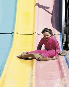 "<div class=""source""></div><div class=""image-desc"">Kaidyn Hudson, 8, of Crittenden, enjoy a slide on the rides at Derby Day.</div><div class=""buy-pic""><a href=""/photo_select/20594"">Buy this photo</a></div>"