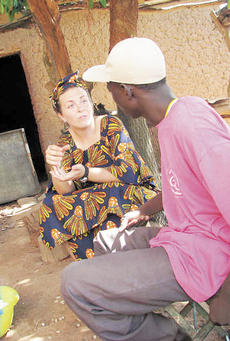 """<div class=""""source""""></div><div class=""""image-desc"""">Krystal Hutchinson talks with a Mali villager during her mission trip to Africa.</div><div class=""""buy-pic""""><a href=""""/photo_select/5746"""">Buy this photo</a></div>"""