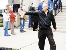 """<div class=""""source""""></div><div class=""""image-desc"""">Bill Page of Grant County pours out a cup of tea to protest high taxes during a Tax Day Tea Party at the courthouse on April 15.</div><div class=""""buy-pic""""><a href=""""/photo_select/5726"""">Buy this photo</a></div>"""