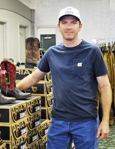 """<div class=""""source""""></div><div class=""""image-desc"""">Tim Mann puts boots on display at R.T. Outfitters in Dry Ridge. Photos by Camille McClanahan</div><div class=""""buy-pic""""><a href=""""http://web2.lcni5.com/cgi-bin/c2newbuyphoto.cgi?pub=195&orig=tim_mann.jpg"""" target=""""_new"""">Buy this photo</a></div>"""