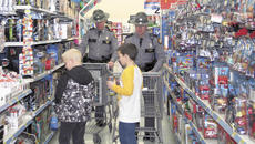 "<div class=""source"">Jamie Baker-Nantz</div><div class=""image-desc"">Trooper David Jones and Scott Allen manned the shopping carts while Michael and Dylan shopped on Dec. 11.</div><div class=""buy-pic""></div>"
