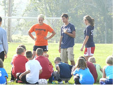 "<div class=""source"">Submitted</div><div class=""image-desc"">Mackenzie Tucker, Jordan Kearns and Sierra Schmitt discuss goalkeeping skills to youth soccer players.</div><div class=""buy-pic""></div>"