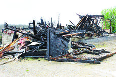 """<div class=""""source"""">Cheyene Miller</div><div class=""""image-desc"""">A fire destroyed a mobile home on Turner Road in Williamstown April 7 and killed Doug Campbell.</div><div class=""""buy-pic""""></div>"""
