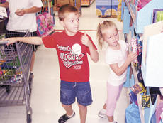 "<div class=""source"">Bryan Marshall, staff writer</div><div class=""image-desc"">Porter and Macy Hedenberg took time this week selecting school supplies.</div><div class=""buy-pic""><a href=""http://web2.lcni5.com/cgi-bin/c2newbuyphoto.cgi?pub=195&orig=twokids.jpg"" target=""_new"">Buy this photo</a></div>"