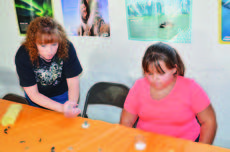 "<div class=""source""></div><div class=""image-desc"">Valerie Prather helps Kristin Wright with an art project. </div><div class=""buy-pic""><a href=""/photo_select/26901"">Buy this photo</a></div>"