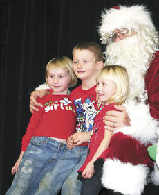 "<div class=""source""></div><div class=""image-desc"">Santa gives DRE students Johnathan, Emily and Kira Wallace a big hug. </div><div class=""buy-pic""><a href=""http://web2.lcni5.com/cgi-bin/c2newbuyphoto.cgi?pub=195&orig=wallace%2527s.jpg"" target=""_new"">Buy this photo</a></div>"