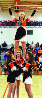 Caitlynn Evans and the JV cheerleaders get the crowd pumped up.