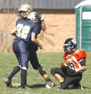 Triston Wallace taps the helmet of Tristan Hudson after he made the tackle on No. 8 of Union.