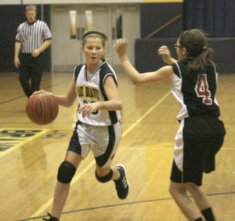Sixth grader Shelby Harmeyer looks for an open lane against Conner Middle School.
