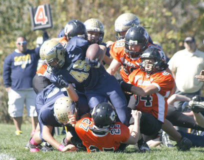 Triston Wallace (45) gets tackled during a run against Union in the first round of the state playoffs.