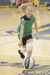 Abby West, 9, of Williamstown dribbles the ball during a scrimmage at camp.