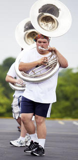 Alex Wheelington  blows in to the tuba