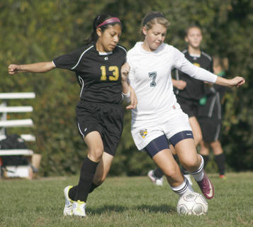 Lady Braves senior Alexis Willen fights off the Carroll County defender, during the 2011 Dry Ridge Toyota Classic, Sept. 17 at Grant County Middle School.