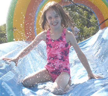 Alyssa Baker smiles as she comes down the slide.