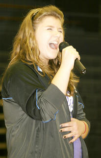 Student Annelise Kinsey entertains her classmates before the contests begin.