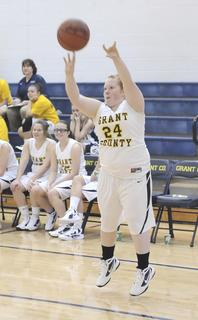 Lady Braves senior guard Ashley Thomason shoots a three-point shot against Scott High School.
