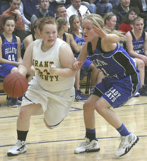 Ashley Thomason drives the lane against Gallatin County.