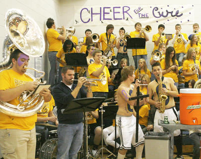 The Grant County High School Pep Band gets ready for the game practicing before the tipoff of the game. The final Coaches vs. Cancer game will be held at Williamstown High School, when the Lady Demons will take on the Lady Braves at 7:30 p.m. Jan. 23.