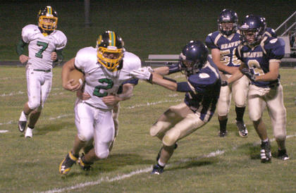 Braves junior Blake Dills makes a tackle during homecoming night against Greenup County.